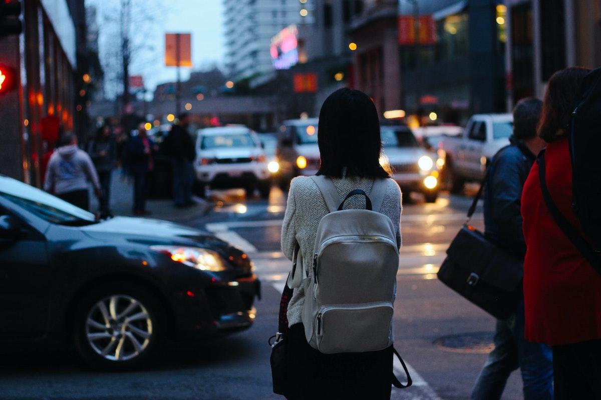 Woman walking alone in a city
