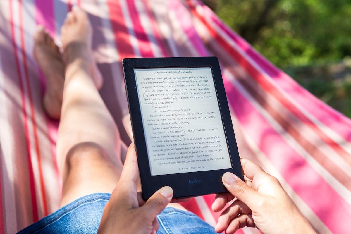 Reading e-reader outdoors